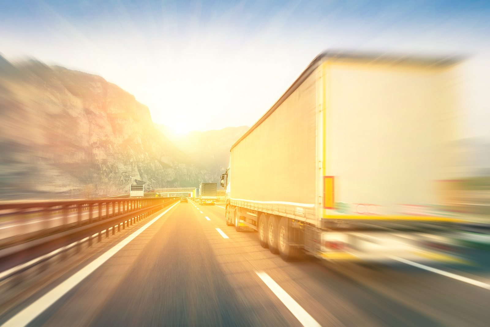 https://live-crossroads-elf.pantheonsite.io/sites/default/files/revslider/image/bigstock-Generic-Semi-Trucks-Speeding-O-95099174.jpg